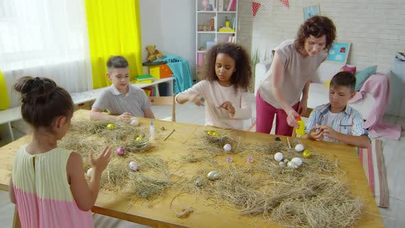 Cover Image for Multi-ethnic Children Decorating Easter Eggs in Art Class