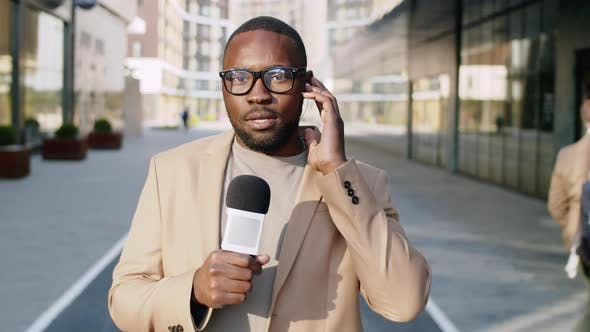 Black Male Journalist Doing a Live Report in the City