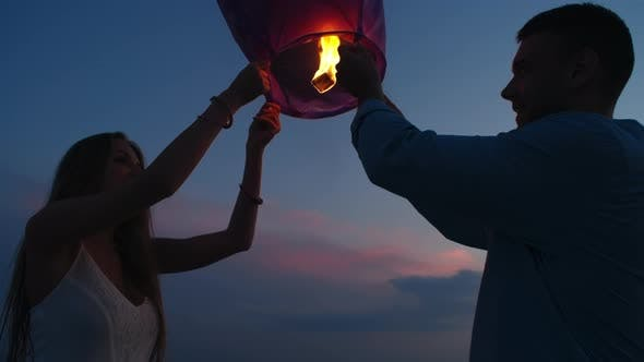 Thumbnail for Couple Releasing Sky Lantern