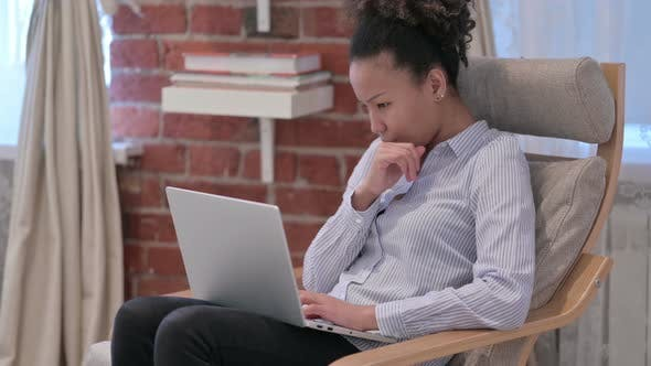 African American Woman Thinking Using Laptop