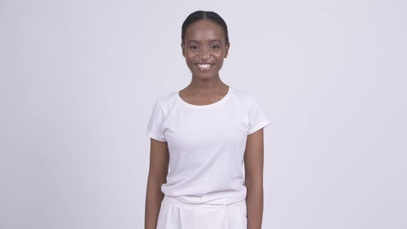 Thumbnail for Young Happy African Woman Smiling Against White Background
