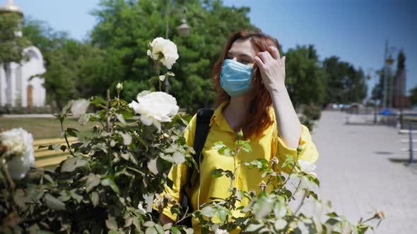 Thumbnail for Young Beautiful Girl Observes Safety Measures During Pandemic and Wears Medical Protective Mask and