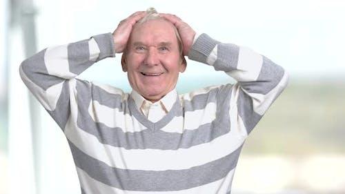 Cheerful Elderly Man Raised Hands in Happiness.