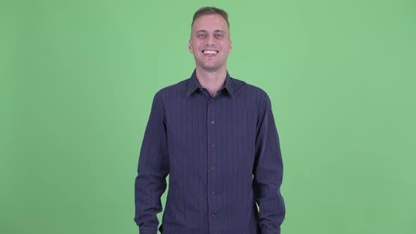 Thumbnail for Portrait of Happy Handsome Businessman Smiling