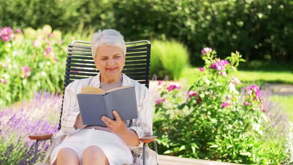 Cover Image for Happy Senior Woman Reading Book at Summer Garden