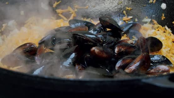 Thumbnail for Close Up Chef Toassing Mussel Pan. Slow Motion V3