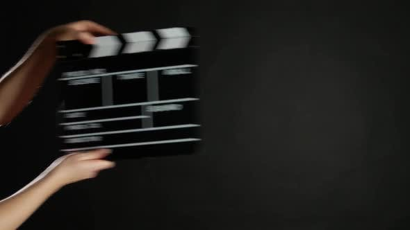 Thumbnail for Hands with Movie Production Clapper Board, on Black