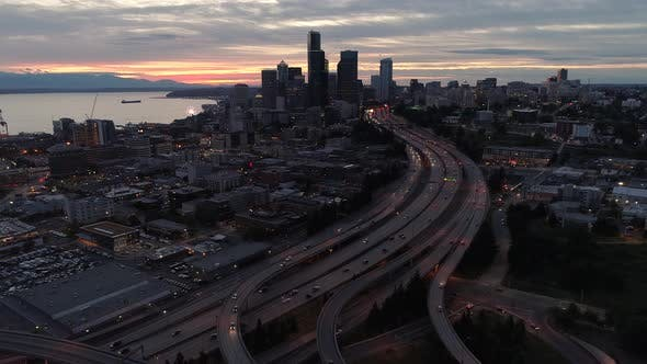 Aerial Hyperlapse Of Seattle City Skyscraper Building Lights Glowing At Night In Visual Effect
