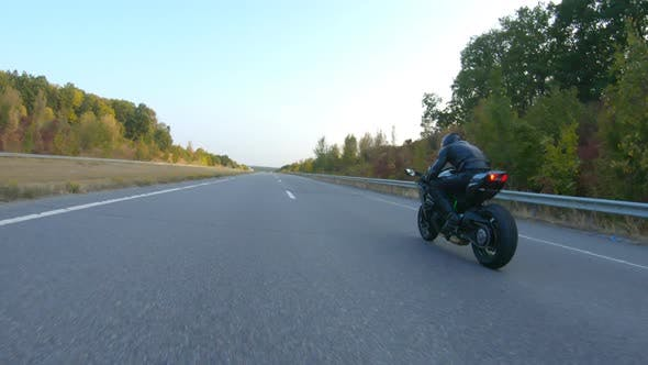 Thumbnail for Follow To Biker Riding on Modern Sport Motorbike at Autumn Highway. Motorcyclist Racing His