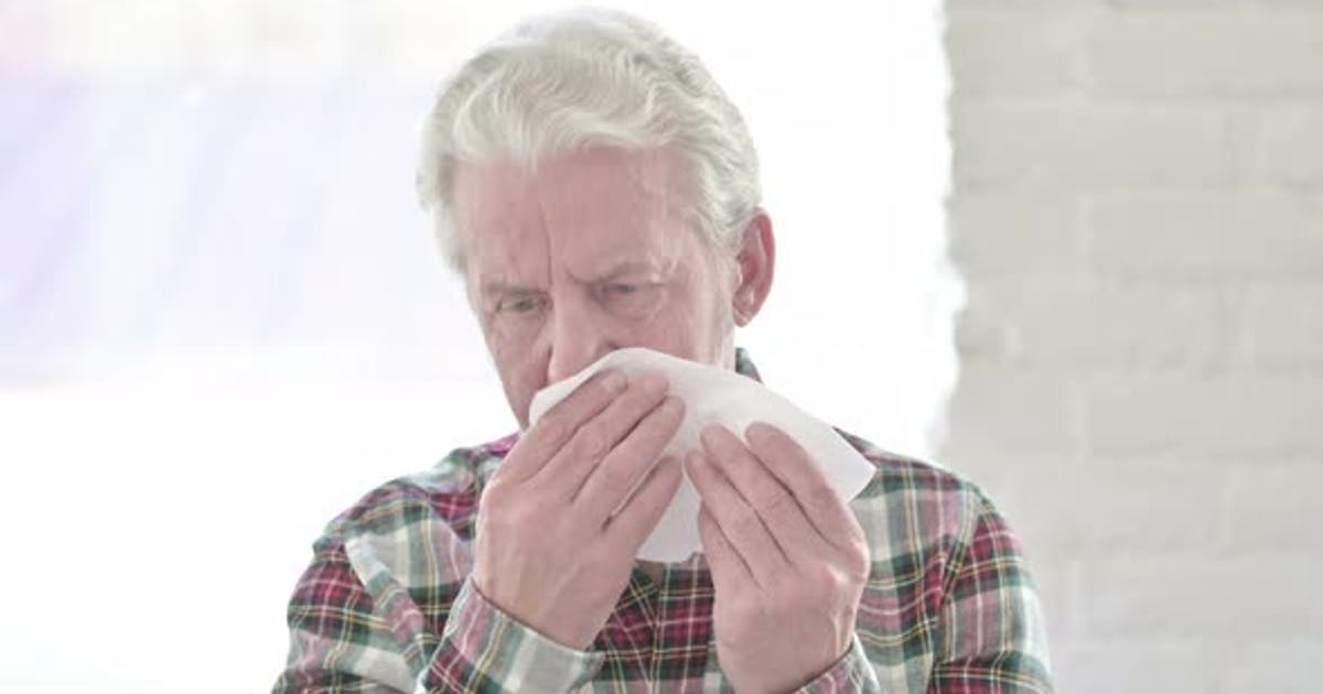 Portrait of Sick Casual Old Man Sneezing
