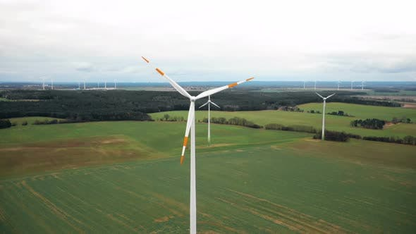 Thumbnail for Drone Rising Above Large Windmill Turbine with Red Blade Stripes, Alternative Sustainable Eco Energy