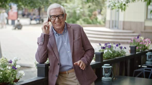 Thumbnail for Cheerful Elderly Man Chatting on Phone