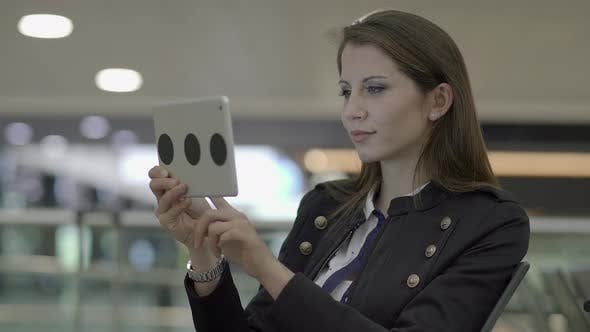 Thumbnail for Young Attractive Woman Using Digital Tablet Browsing the Web