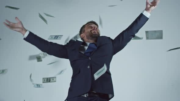 Thumbnail for Happy Businessman Catching Dollars