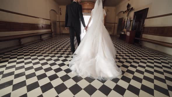 Thumbnail for Newlyweds. Caucasian Bride and Groom Walking Together in an Old Church. Wedding
