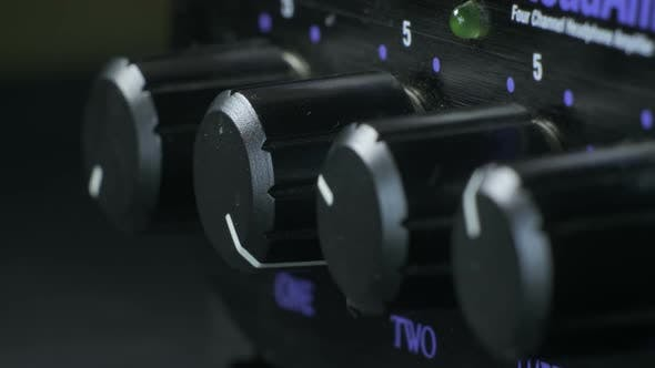 Thumbnail for Fingers Turning Headphone Amplifier Knob