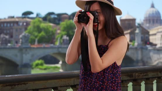 Thumbnail for Closeup of Asian millennial photographer taking pictures by the Vatican in Rome
