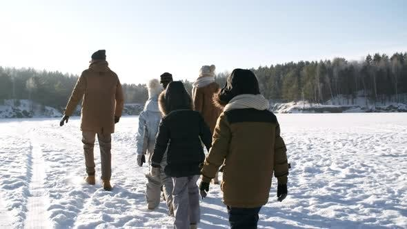 Thumbnail for Family Walking in Bright Sunshine in Winter