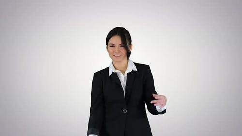Brunette Businesswoman Dancing on Gradient Background.