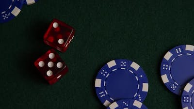 Rotating shot of poker cards and poker chips on a green felt surface - POKER 023