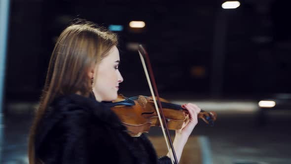 Thumbnail for Cute Girl with Long Hair is Playing the Violin in the Square in the City Center