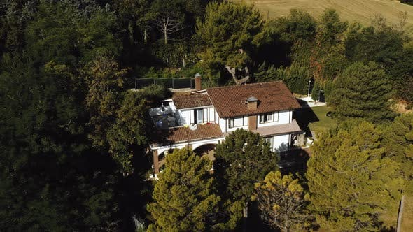 Thumbnail for Drone Flying Around Magnificent Travel House Mansion in Italy on a Hill Surrounded By Green Trees on