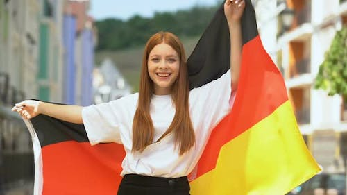 Cheerful Teenager Waving Flag of Germany and Smiling on Camera, National Holiday