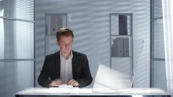 Thumbnail for Caucasian Businessman Working on Innovative Computer with Transparent Display