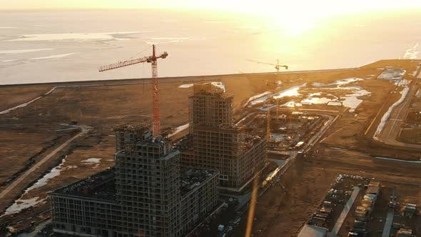 Thumbnail for Aerial View of the Construction Site with Construction Cranes at Sunset