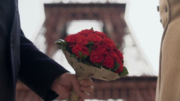 Thumbnail for Guy Showing His Affection to Girlfriend, Presenting Woman with Bouquet of Roses