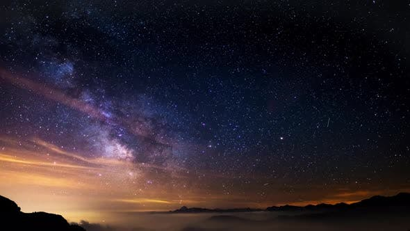 Thumbnail for Night Sky on The Alps, Time Lapse Milky Way Stars Rotating Over Mountains