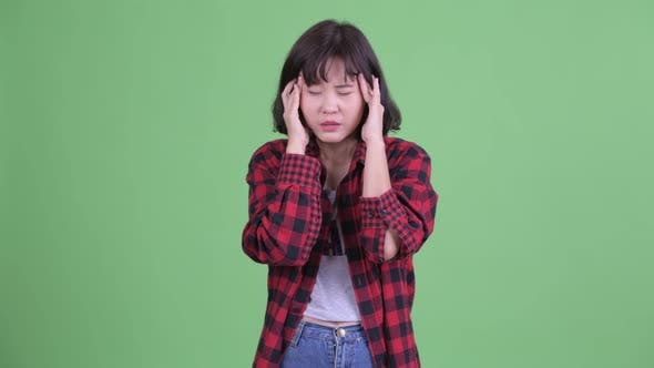 Thumbnail for Stressed Asian Hipster Woman Having Headache