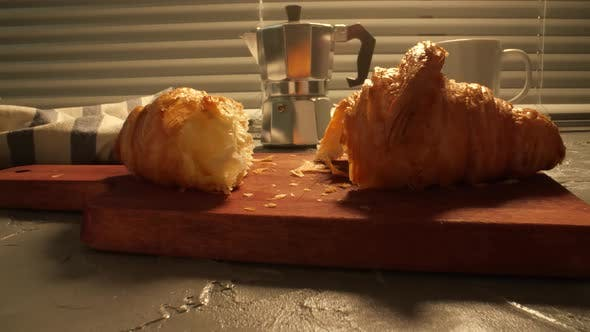 Food and Drink Concept. Morning Breakfast - Coffee and Croissant on a Table
