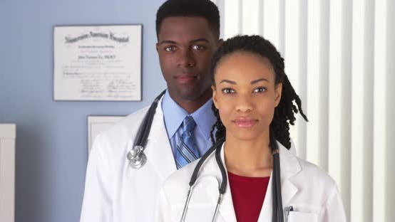 Thumbnail for Close up of man and woman African American doctors in hospital