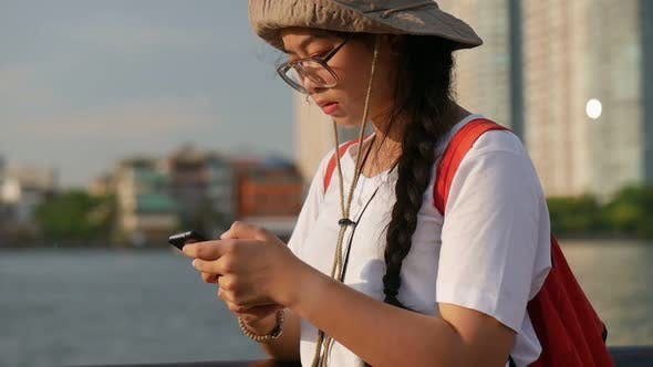 Young Asian women using mobile chatting online.