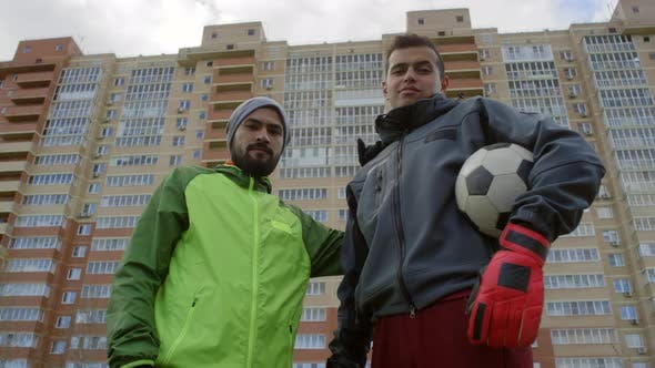 Thumbnail for Two Middle Eastern Friends Posing for Camera after Playing Soccer Outdoors