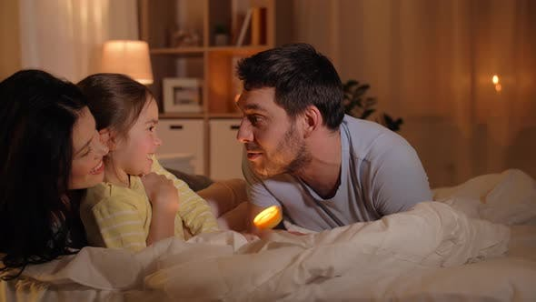 Thumbnail for Happy Family with Torch Light in Bed at Home 19