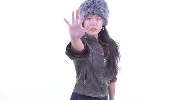 Cover Image for Serious Asian Woman Showing Stop Gesture
