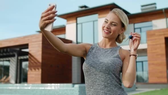 Thumbnail for Happy Woman Taking Selfie with House Keys Near Luxury House