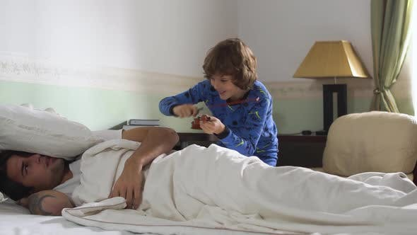 Thumbnail for Older Brother Sleep in Bed and Younger Brother Wake Him Up While Playing the Violin