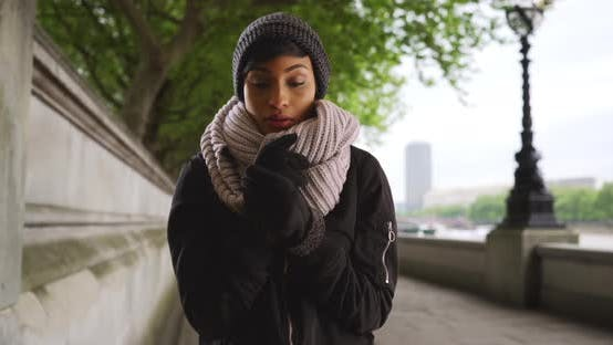 Thumbnail for Attractive young black woman outside on overcast day in London, England