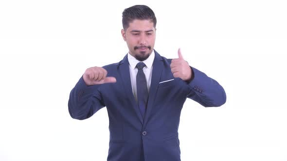 Thumbnail for Confused Bearded Persian Businessman Choosing Between Thumbs Up and Thumbs Down