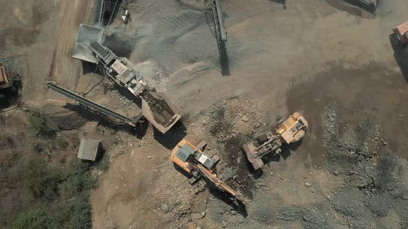 Top View of Heavy Machiery Working at Quarry