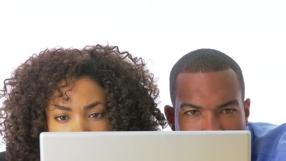 Thumbnail for Close up of two businesspeople looking at computer screen