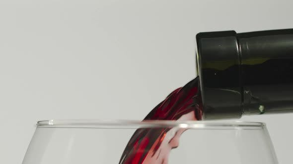 Cover Image for Pouring red wine from a bottle into a glass