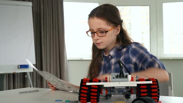 Thumbnail for Little Girl Explores the Instruction of Construction Set