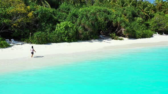 Thumbnail for Young fun woman relaxing having fun on the beach on paradise white sand and blue 4K background