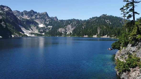 Thumbnail for Man Jumps Off Cliff In Alpine Lake Wilderness Does Frontflip Into Blue Water