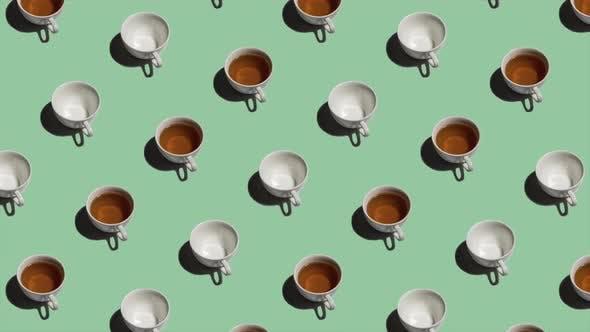 Thumbnail for Muster mit vielen Teetassen und leeren Tassen animiert auf hellgrünem Hintergrund