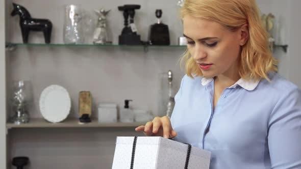 Thumbnail for The Girl Checks the Packing Box